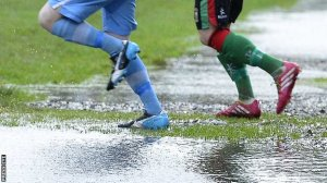 Deciding whether a hard pitch or waterlogged pitch is better is proving difficult for some NIFL clubs